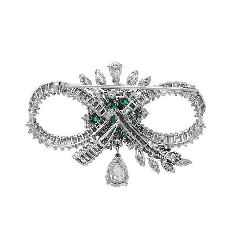 Women's Mid-Century Emerald Diamond Platinum Bow Brooch For Sale