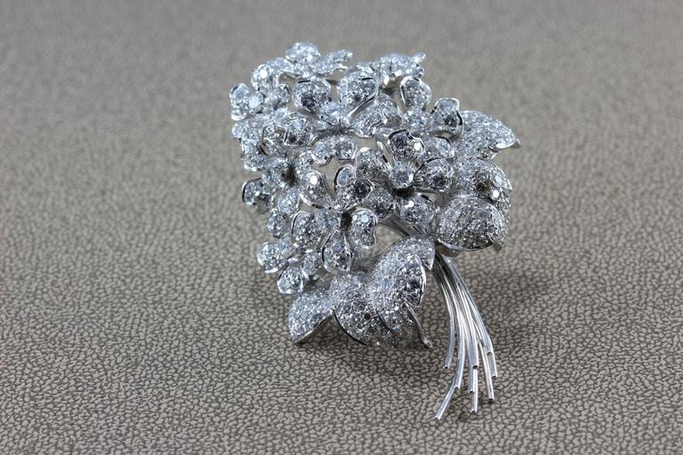 A diamond studded bouquet of flowers, this brooch features over 7 carats of diamonds set in 18K white gold. The pedals dance with light, this is one bouquet worth fighting over!  Dimensions: 2.60 x 1.75 inches
