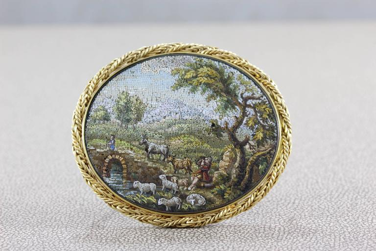 A beautiful realist landscape painted with nothing but small pieces of marble and stone, this is a high quality micro mosaic made in the Victorian era. It has a lavish woven gold frame enhancing the overall look of the piece.   Dimensions: 1.95 x