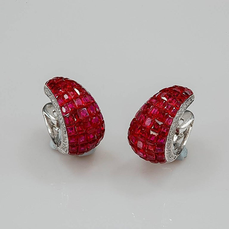 Ruby invisible hoop Earrings uses the top quality ruby which make in invisible setting.We set the stone in perfection as we are professional in this kind of setting more than 40 years.The invisible is a highly technique .We cut and groove every