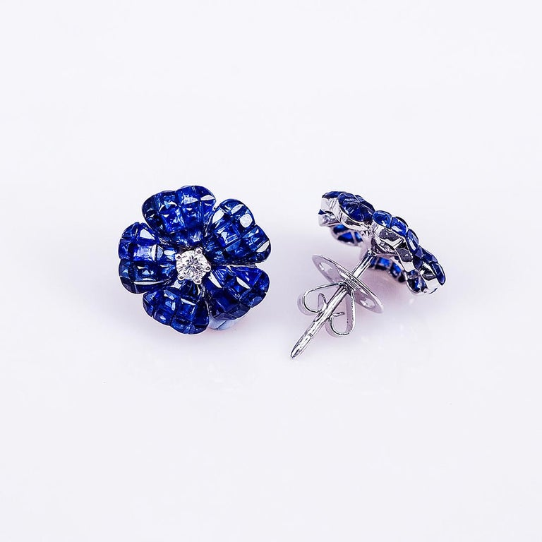 Modern 18 Karat White Gold Invisible Sapphire Flower Stud Earrings For Sale