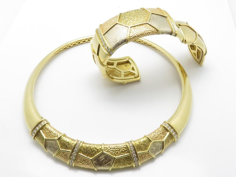 Set of necklace and large rigid bracelet made of different shades of 18k gold. center parts have been mated into geometrical designs each separated by diamond lines. Necklace and bracelet signed V C A 750 French assay marks. Circa