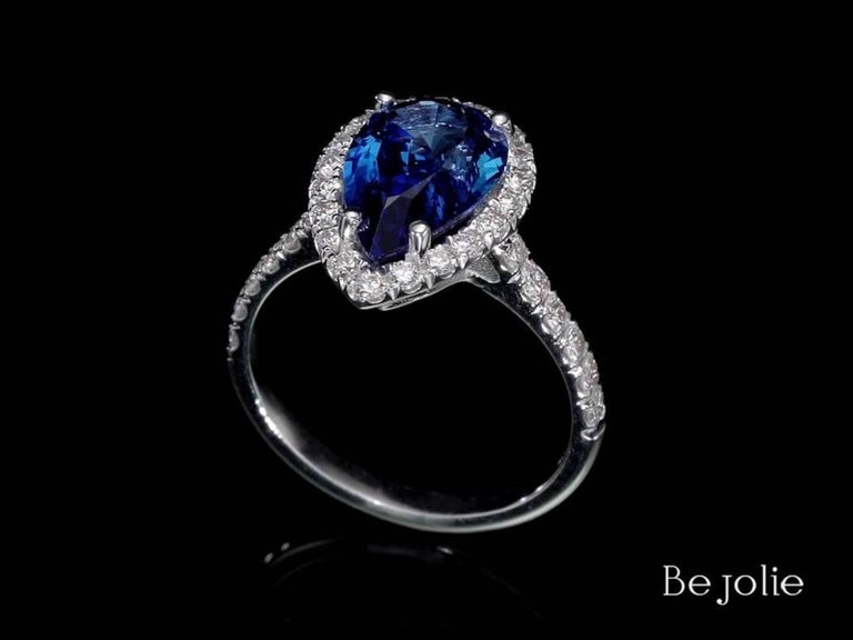 Pear Cut 3.53 Carat Pear Shape Blue Sapphire and Diamond  Engagement Ring For Sale