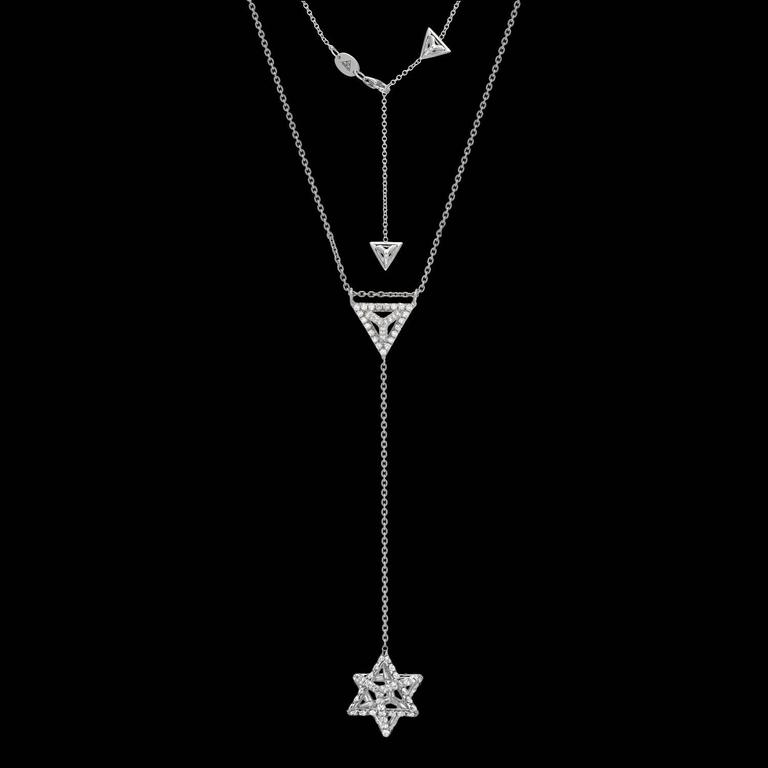 "A limited edition Merkaba platinum necklace, featuring a total of 1.52ct, F-G color and VVS2-VS1 clarity, round brilliant diamonds. This heirloom-quality three dimensional Merkaba star, suspends elegantly at the chest, measuring 0.68"". The chain"