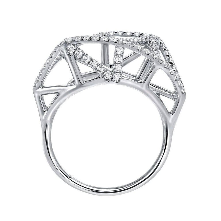 Conversational 0.65ct., collection quality, single-cut diamond lattice ring, hand crafted in 18K white gold. Size 6. Re-sizing is complimentary upon request.  ***Returns are accepted within 7 days of delivery and will gladly be paid by us. Rings