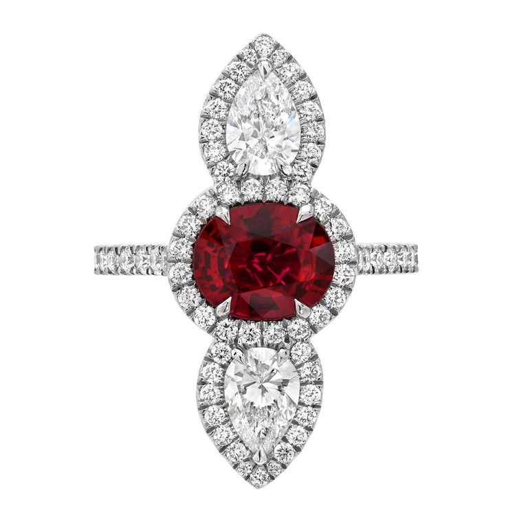 Pristine natural Ruby ring featuring a 2.09 carat unheated Ruby oval, and a pair of GIA certified 1.01 carat pear shaped diamonds, D/VVS2-VS1, set vertically in this breathtaking platinum setting. The round brilliant diamonds framing the ring weigh