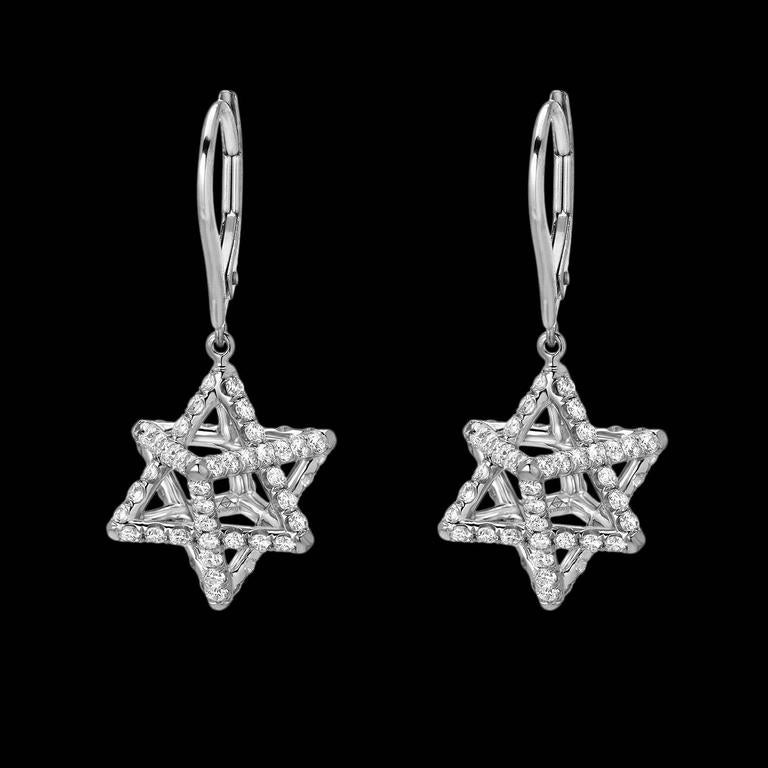 Merkaba platinum drop earrings feature a suspended diamond Merkaba star measuring 0.57 inches, set with a total of approximately 2.02 carats of round brilliant diamonds, F-G color and VVS2-VS1 clarity. These heirloom quality earrings, 1.1 inches in