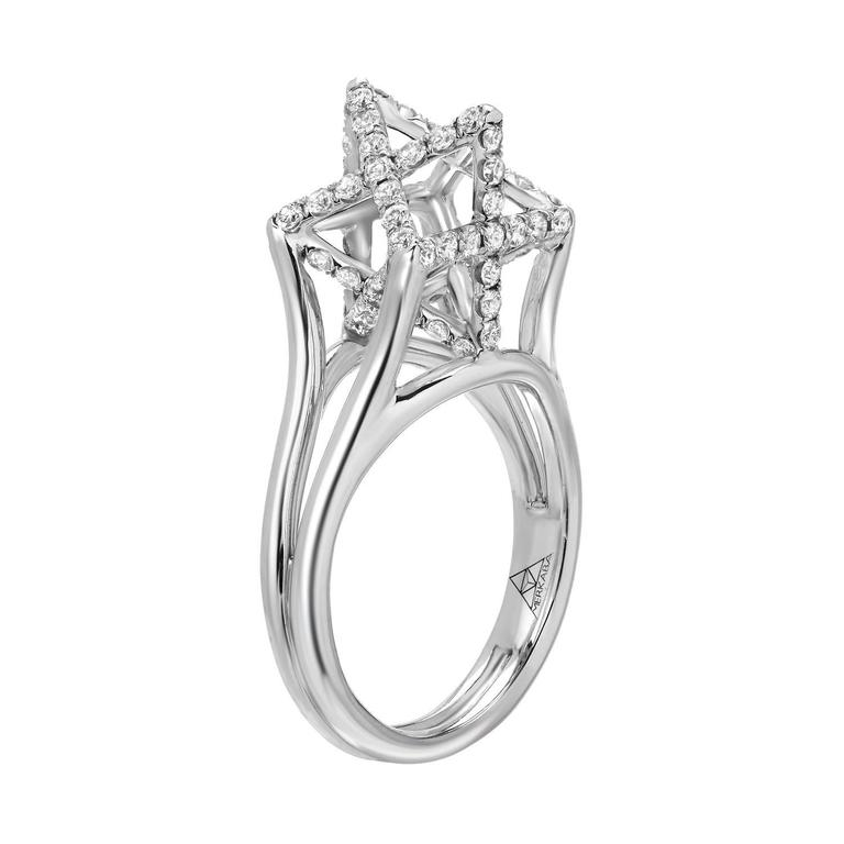 Merkaba platinum ring featuring a total of approximately 0.98 carats of round brilliant diamonds, F-G color and VVS2-VS1 clarity. This dramatic, architectural design extends upward from the hand, 0.43 inches, a stunning three-dimensional symbol of
