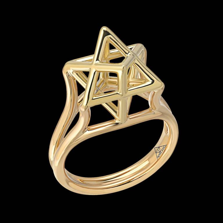 This Merkaba 18k yellow gold ring, features an architectural design, extending upward from the hand, 0.43 inches, a stunning three-dimensional Star of David. Size 6. Can be resized to fit. *Each piece comes with a certificate of authenticity and