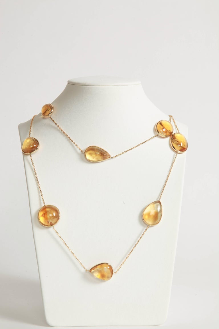 Honey colored necklace, 83.5cm long. Twelve citrine cabochons weight: 193.74carats on a 18K yellow gold chain. Total weight: 47.82 grams Created by Marion Jeantet, French assay mark Price without local taxes