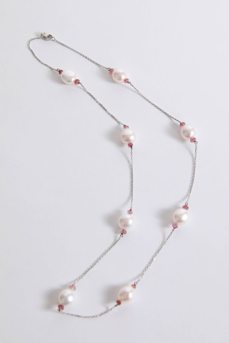 18k white gold necklace, 54cm long, eight freshwater pearls with pink tourmalines faceted  washers created by Marion Jeantet. Total weight: 13.58grams French assay mark Price without local taxes