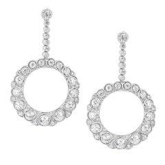 A pair of early 20th century diamond-set hoop drop earrings