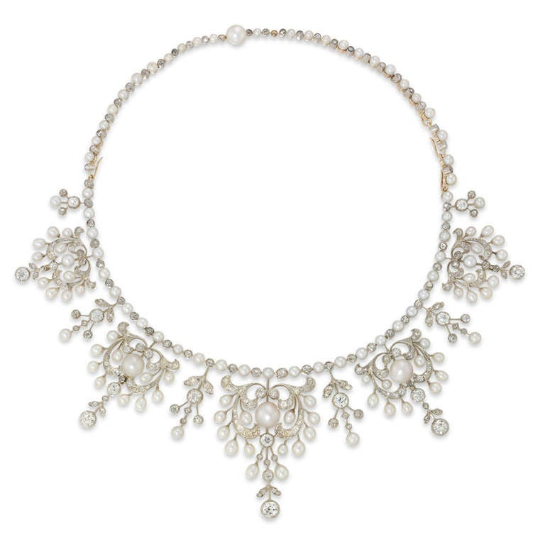 A Victorian Natural Pearl  and Diamond Tiara Necklace, the pearl and diamond ornate scrolls graduated from the centre and suspended from a row of alternate pearls and diamonds, circa 1890.
