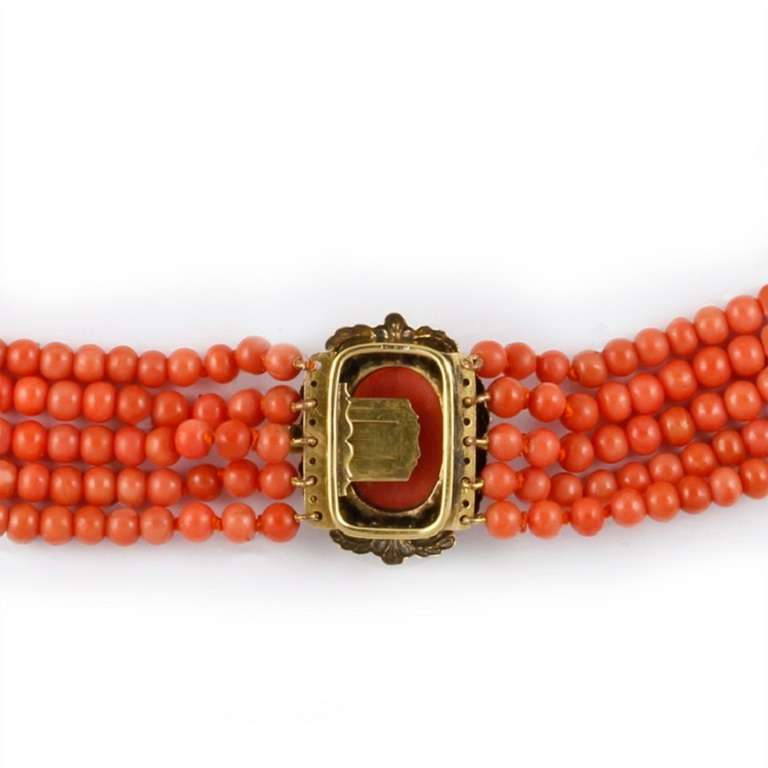A Victorian  five-row graduating coral beads necklace, the first row comprised of 80, the second 85, the third 90, the fourth 99 and the fifth 104 coral beads measuring from 5.2 mm to 8mm attached to a ornate Victorian gold and coral cameo clasp