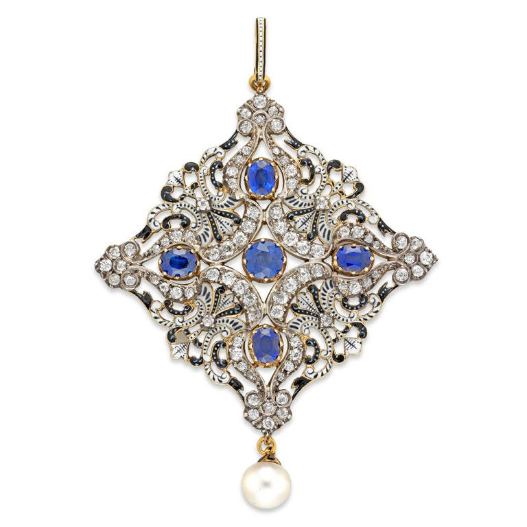 An important Carlo and Arthur Giuliano enamel, diamond and sapphire necklace signed C & AG, the  necklace comprising pierced feathered scrollwork sections finely enamelled with black and white, linked alternately with similarly enamelled