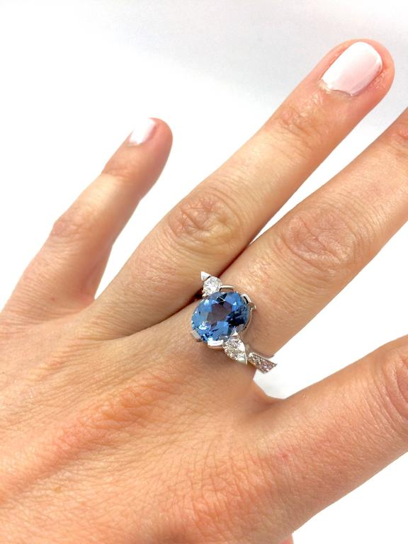 A white gold ring set in the middle with an aquamarine surrounded by a brilliant cut diamond on each side. Eight brilliant cut diamonds are setted on the ring's body. The ring is a G.MINNER unique creation entirely handemade. Aquamarine Weight: 2.47