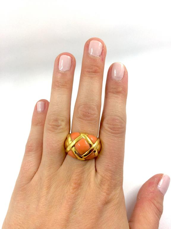 A yellow gold ring composed with coral. Net Weight: 17.60 grams Finger Size: 6.6 (can be sized)