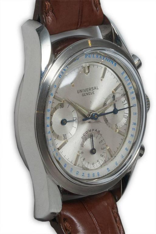 FACTORY / HOUSE: Universal Geneve Watch Company STYLE / REFERENCE: Three Register Chronograph / Valjoux Caliber METAL / MATERIAL: Stainless Steel  DIMENSIONS: 45mm X 36mm CIRCA: 1950's MOVEMENT / CALIBER: Manual Winding / 17 Jewels / Cal. 130 DIAL /