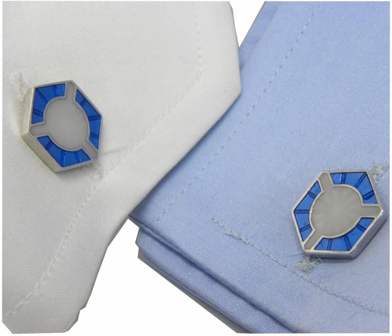 A limited edition of a 1930 pair of cufflinks from our archives, Champlevé enamel, sterling silver setting, T-bar back.
