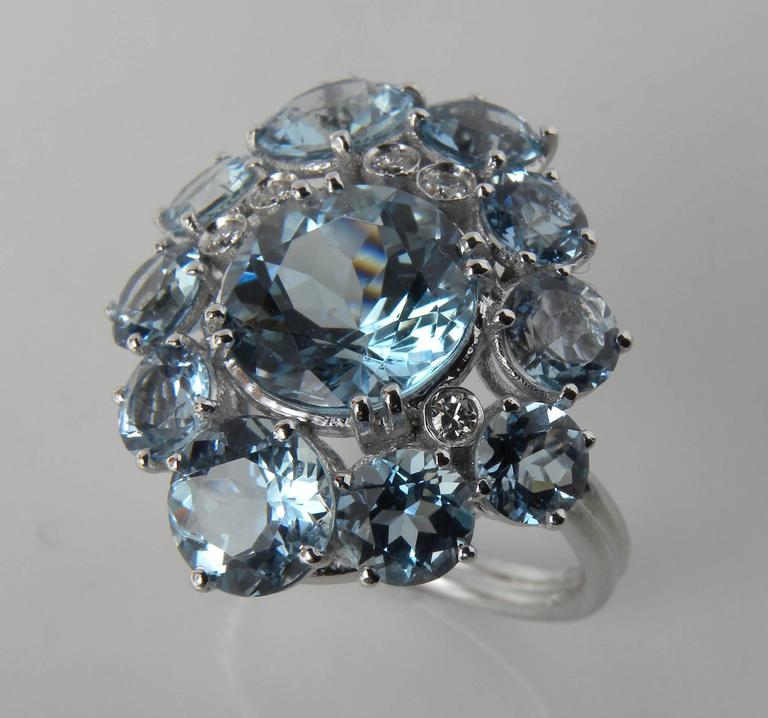 Sumptuos cocktail ring: 10 brilliant cut Aquamarines and 5 white diamonds surround a round brilliant Aquamarine of 3.26 Carat, 18 Carat white gold setting.  All aquamarines are from Brazil. US size 7.25 French Size 55 It can be resized on request