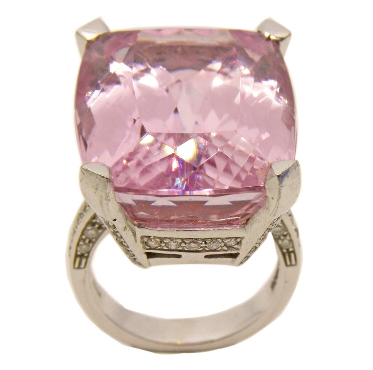 Beautiful, one-of-a-kind cocktail ring, part of our private collection, featuring a 27 Carat Natural Kunzite Antik Cushion Cut, 0.72 Carat White Diamond (F-G, Vs1) 18 Carat White Gold Setting. US size 5 3/4, French Size 51 1/2. We offer