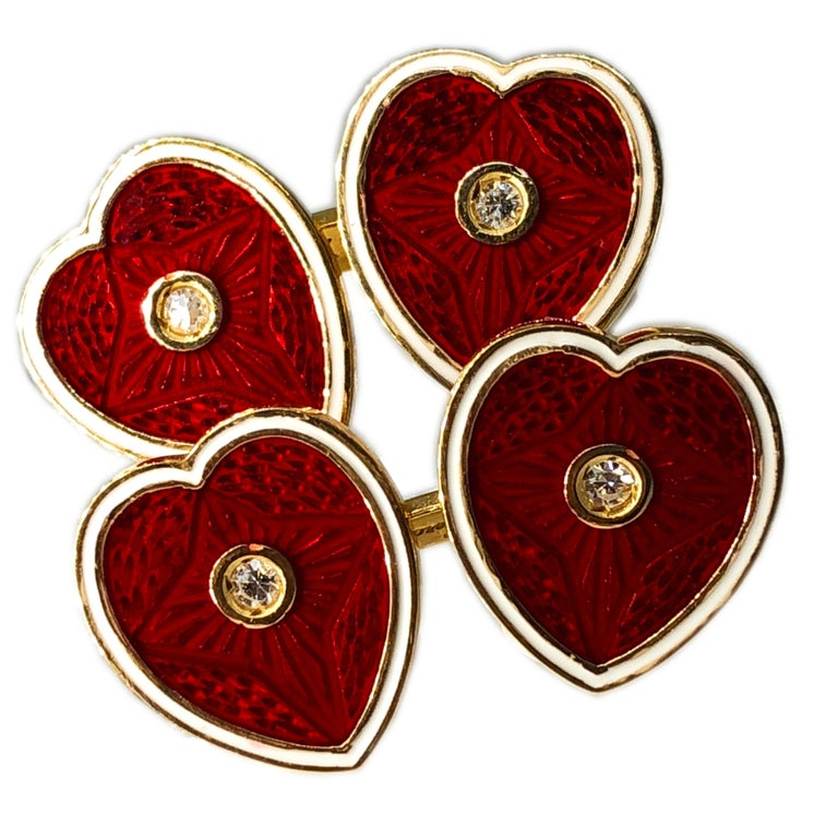 Chic and glamorous, timeless yet not traditional cufflinks: the white edge red hearts are enamelled using champlevé technique, four white diamonds(0.12k) in a yellow gold setting complete this little work of art. In a fitted black box case. 24