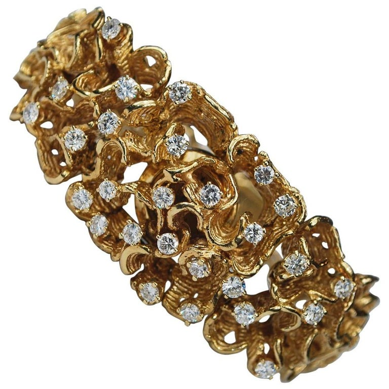 Modernist Diamond 14 Karat Gold Bracelet Hidden Watch, circa 1960