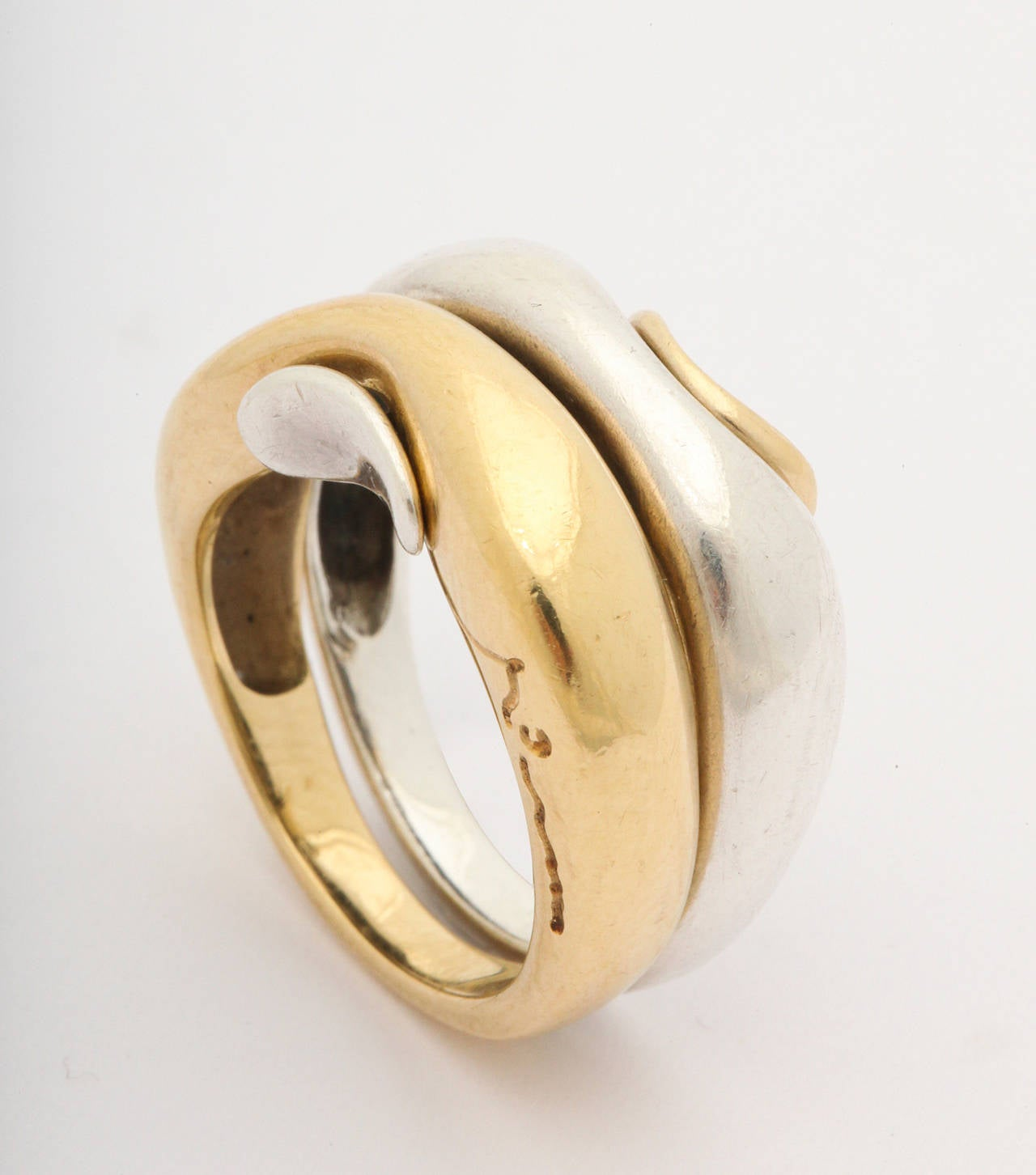 silver gold puzzle ring by minas spiridus for george