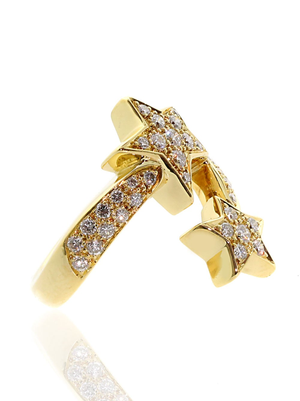 A magnificent Chanel ring from the Comete collection featuring 39 VS1 E-F Color Round Brilliant Cut Diamonds set in 18k Yellow Gold. The ring measures .90