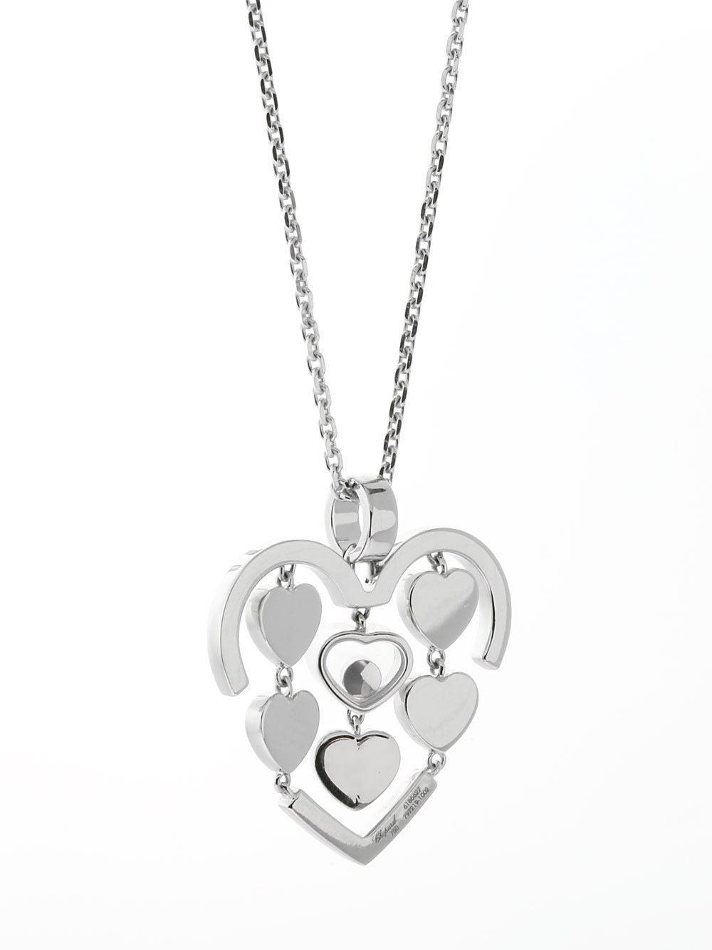 A magnificent authentic Chopard necklace featuring a multitude of delicate hearts enhanced with an iconic Chopard happy diamond (.05ct) set in 18k white gold.