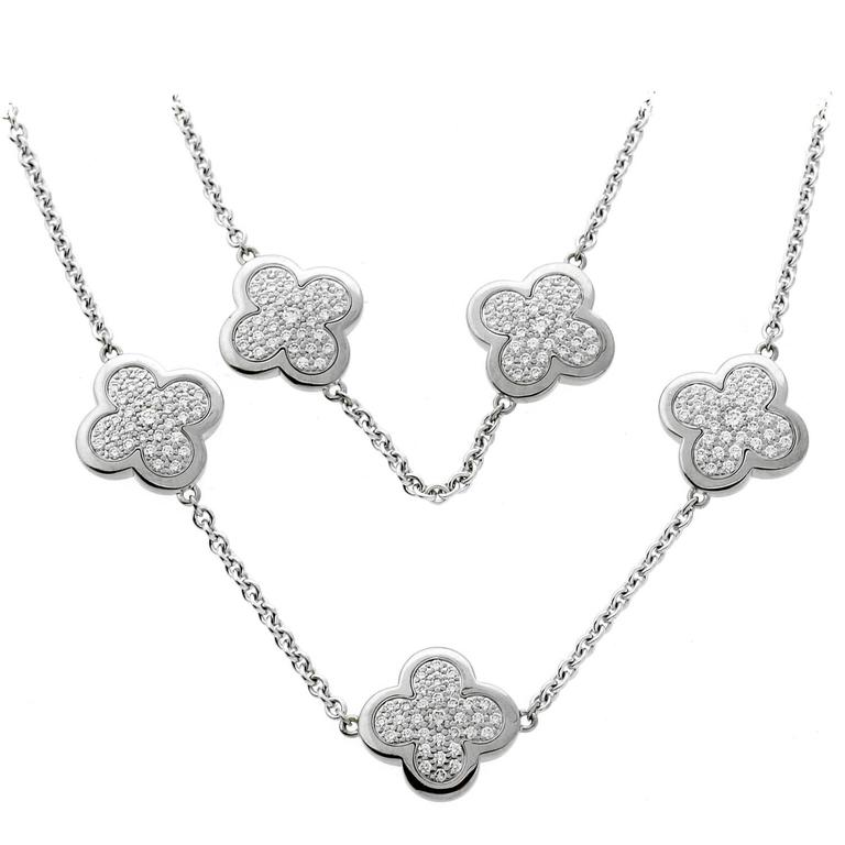 Van cleef and arpels diamond gold pure alhambra necklace at 1stdibs an iconic authentic van cleef arpels necklace featuring 9 motifs set with the finest van aloadofball Image collections
