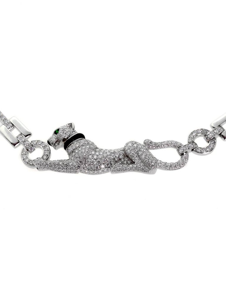 A beautiful authentic Cartier necklace from the Panthere collection crafted in 18k white gold and adorned with 3.71ct of round brilliant cut diamonds.  Cartier Retail Price: $85,000 + Tax  Inventory ID: 0000326