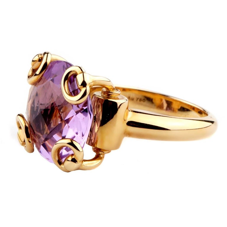 A fabulous Gucci ring showcasing a round checkerboard cut amethyst encased in 18k yellow gold.  Size 6.25