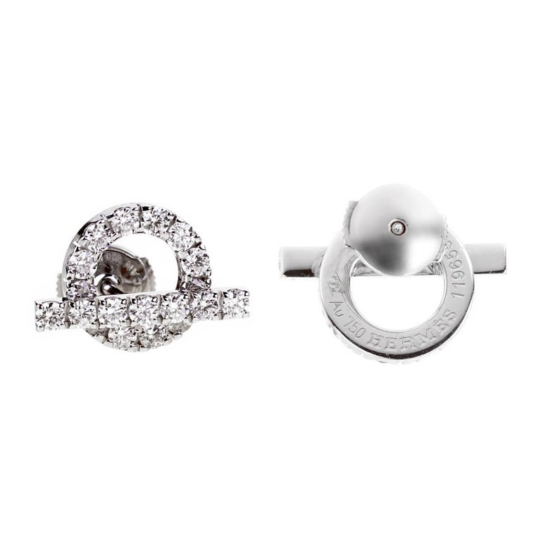 A stunning pair of Hermes earrings featuring 1.14 of the finest Vvs Hermes round brilliant cut diamonds in 18k white gold. The earrings measure .60