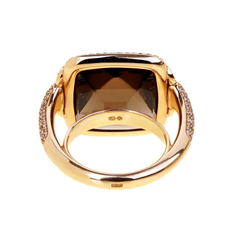 "A magnificent Hermes ring crafted in 18k rose gold featuring round brilliant cut chocolate and fancy brown diamonds showcasing an impressive smokey quartz.  The ring has a length of .75"" by 1"" wide. Size 53 EU / US 6.25"