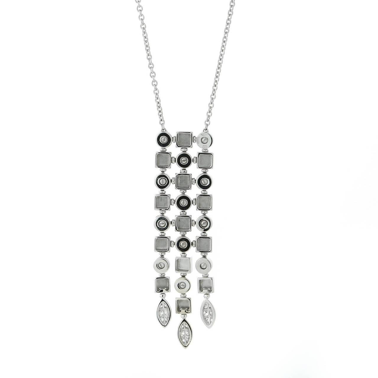 Designed to impress this authentic Bulgari Lucea necklace is adorned with the finest Bulgari Vs Quality round brilliant cut diamonds set in 18k white gold.   Dimensions: .62″ Inches wide by 2.40″ Inches in length Necklace Length: Adjustable