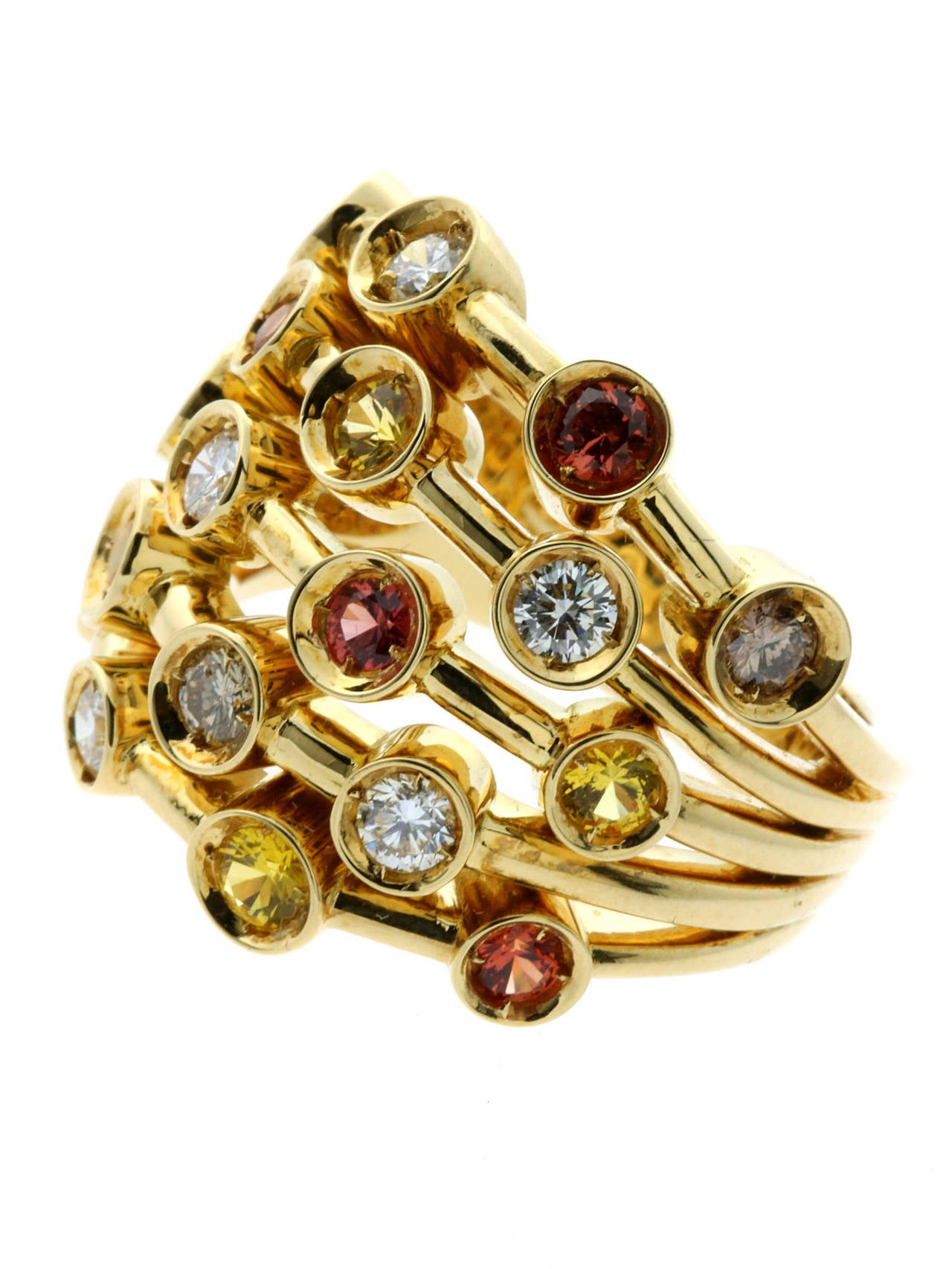 A magnificent authentic Chanel cocktail ring featuring  a brilliant assortment of multicolored fancy sapphires and both white & fancy brown diamonds set in 18k yellow gold.