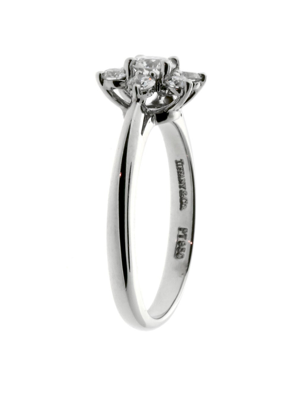 A fabulous authentic Tiffany & Co diamond ring featuring a floral pattern composed of the finest Tiffany & Co Vs Quality round brilliant cut diamonds. (.50ct) in platinum.