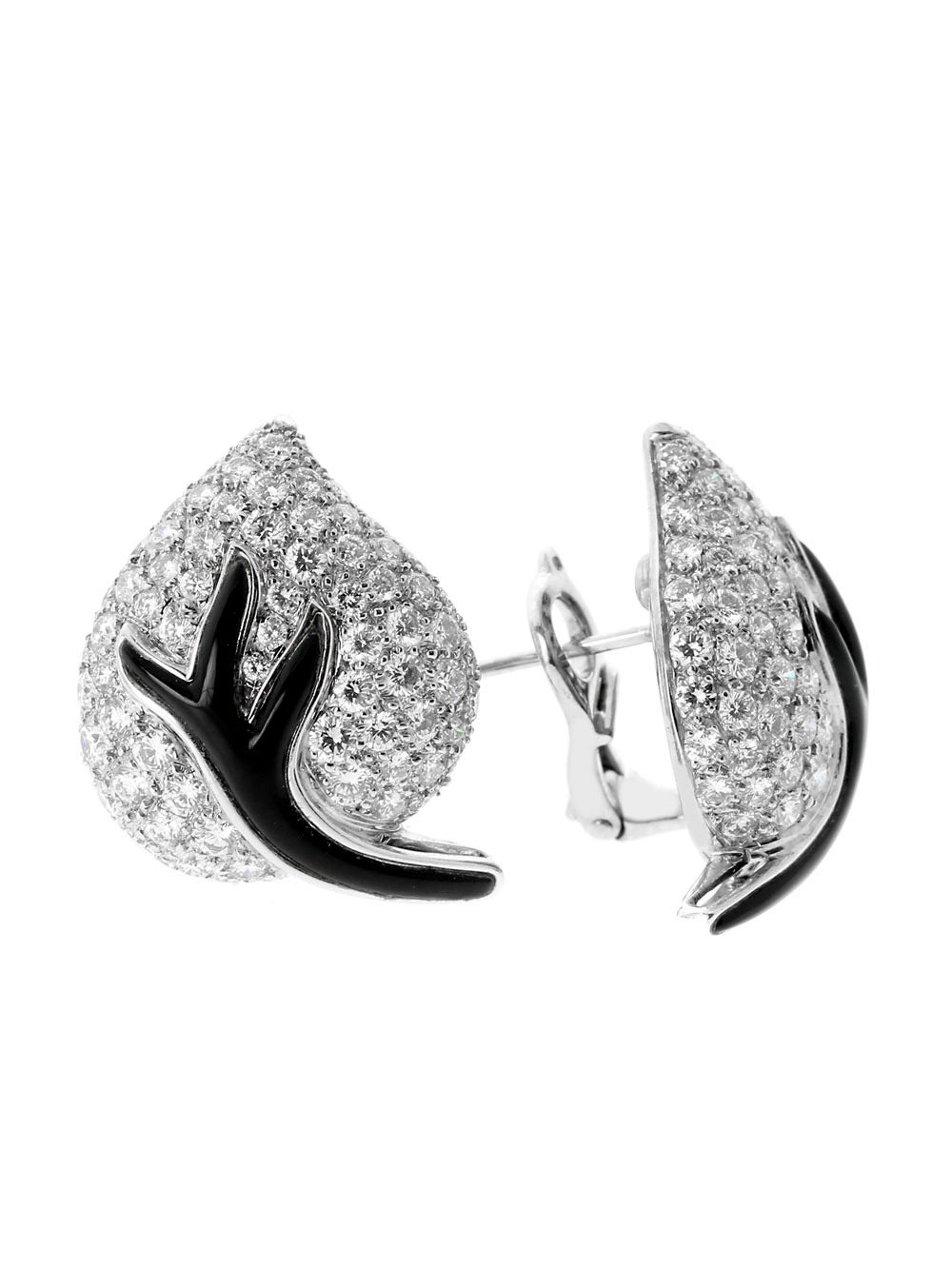 A magnificent pair of authentic Chanel earrings set with the finest Chanel round brilliant cut diamonds (5.5ct appx), and black onyx set in 18k white gold.