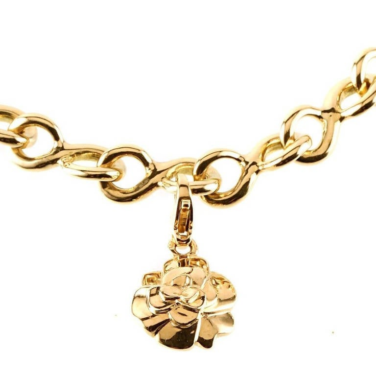 Chanel Camelia Gold Charm Bracelet In New Condition For Sale In Feasterville, PA