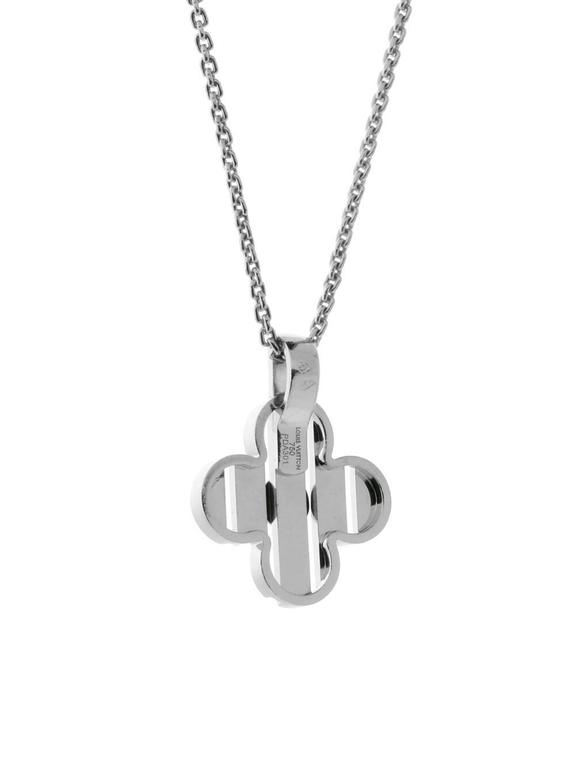 A playful, chic diamond necklace by Louis Vuitton featuring the signature Fleur motif adorned with 1 round brilliant cut diamond, suspended by a Louis Vuitton 18k white gold necklace measuring 16