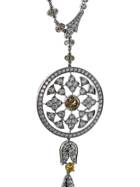 A magnificent Cartier Surya necklace lavishly set with 328 of the finest Cartier diamonds (57.98cts) in platinum.   1 Fancy Brown Diamond Weighing 1.01ct 10 Diamond Pearl Beads 7.61ct 64 Brown Diamond Briolettes 40.9ct 1 Fancy Yellow Round
