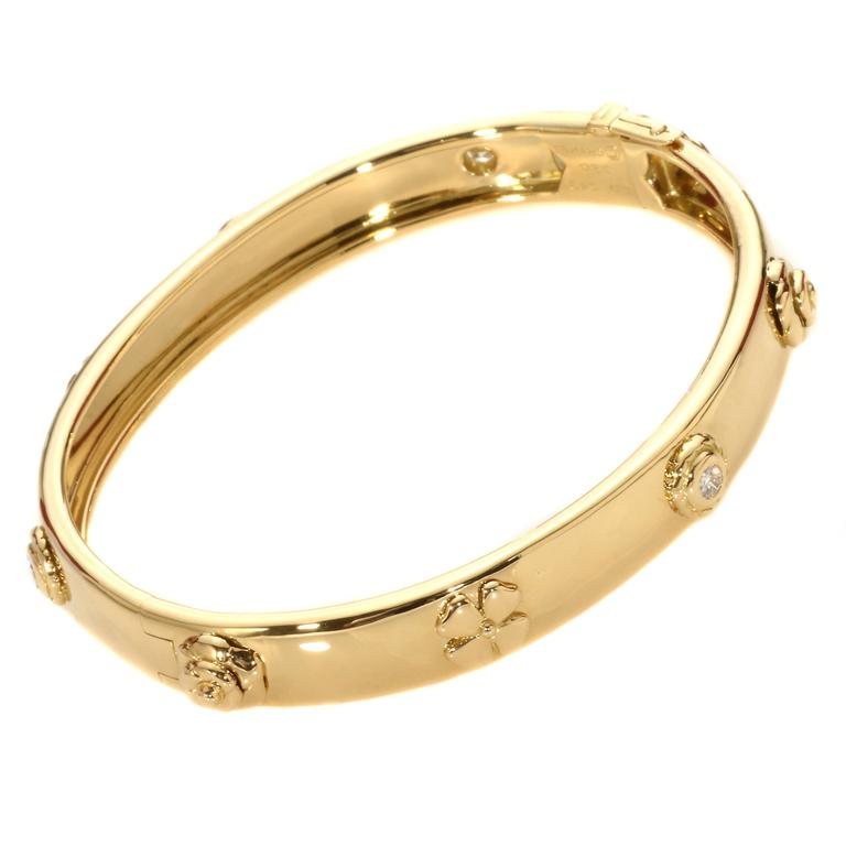 f9b0872a03f0 An exceptional Chanel 18k yellow gold diamond bangle part of the posh  Caméllia collection