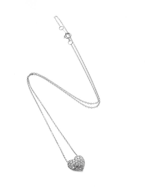 A magnificent Cartier diamond heart draped with magnificent round brilliant cut diamonds set in platinum. The necklace measures 16″ in length,  Dimensions: The pendant has a diameter of 11mm (.43″ Inches)  Inventory ID: 0000102
