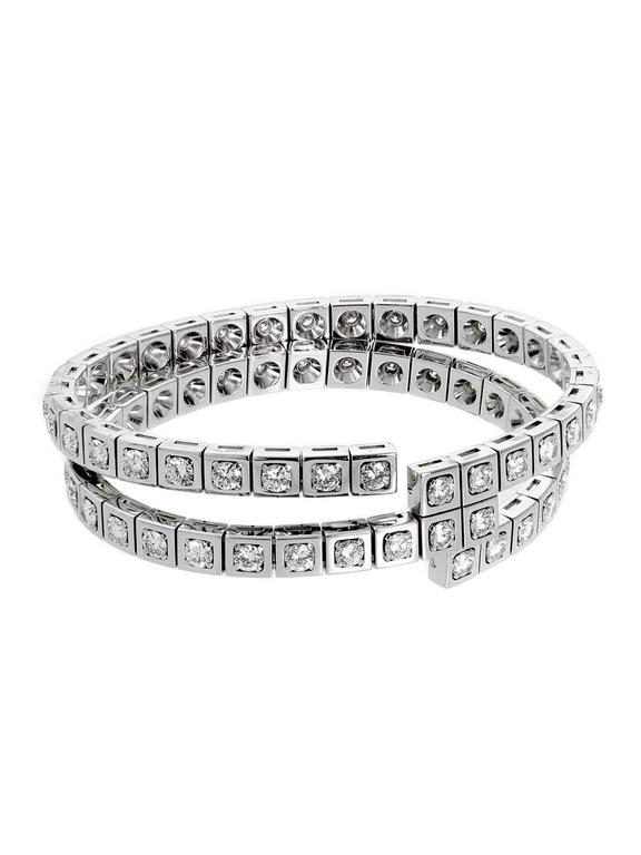 A chic diamond wrap bracelet by Cartier featuring 9.90cts appx of round brilliant cut vs quality diamonds set in 18k white gold. 