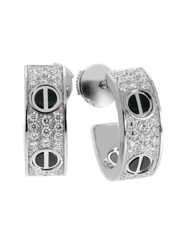 A Fabulous Pair Of Cartier Love Diamond Earrings Featuring Ceramic Motifs Adorned With