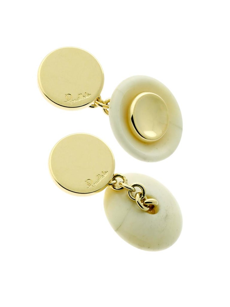 A chic pair of Pomellato cufflinks in 18k yellow gold, featuring marble discs.  Retail: $1920  Inventory ID: 0000318