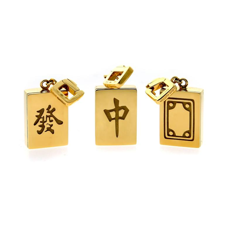 """An exceptionally rare Louis Vuitton """"Mahjong"""" tile set crafted in 18k yellow gold made for the grand opening of the Louis Vuitton boutique in Hong Kong. Limited to 88 pieces, each tile is numbered 9/88.  They may be worn on a charm bracelet or as"""