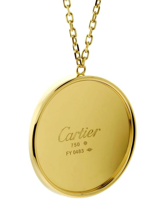 A fantastic statement necklace by Cartier from the Love collection. This beautiful 18k yellow gold necklace will radiate warmth.  Pendant Dimensions: 1.37 Inches Necklace Length: 16.5 Inches  Inventory ID: 0000358
