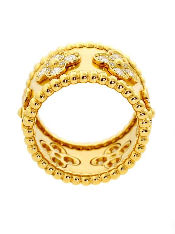 Van Cleef & Arpels Perlee diamond ring in 18k yellow gold featuring a beaded edge followed by the iconic Alhambra motif adorned with 48 fine round brilliant cut diamonds.  Size: EU 51     US 5 3/4  Diamonds: 48 Round Brilliant Cut If-Vvs1